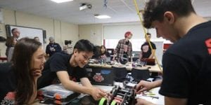 Team members working on robot