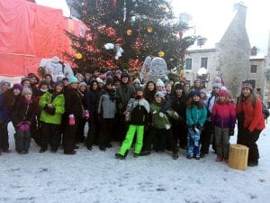 Middle school students outdoors in snowy Quebec