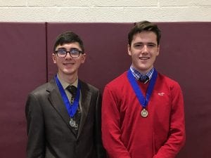 Two boys wearing medals