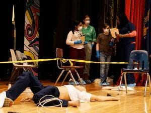 Students and scientist work on mock crime scene