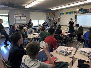High school teachers teaching lesson to eighth-grade math class
