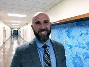 Rudy Arietta, incoming TZHS principal, smiling in hallway