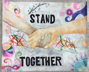 "Poster of clasped hands with text ""Stand Together"""