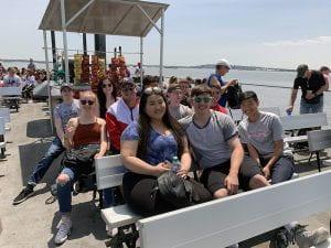 Students on top deck of Ellis Island Ferry