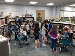 Students in new WOS library with teachers