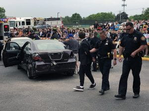 Student walking away from mock accident with police officers