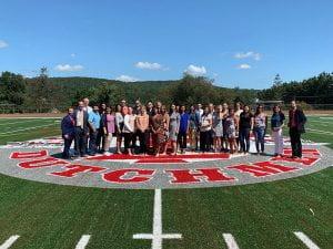Photo of group of new teachers on turf football field