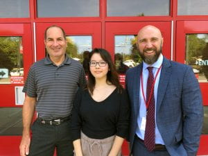 NMS Semifinalist Hannah Ahn with school counselor Randy Altman and Principal Rudy Arietta