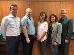 Five Board members, smiling