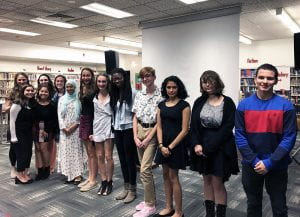 English honor society members and advisor standing in a line in the school library