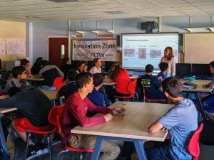 BOE member and engineer Christine Lee speaks to PLTW students at TZHS