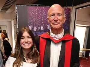 Alumna Lily Samett with dissertation advisor at college graduation