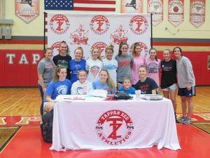 "TZHS Girls Basketball Team ""signs"" New Member"