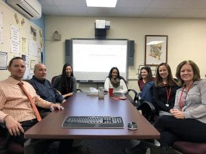 South Orangetown Middle School's Student Support team, seated at table
