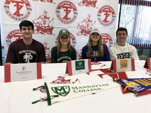 Student-athletes in college gear for NLI Signing Day