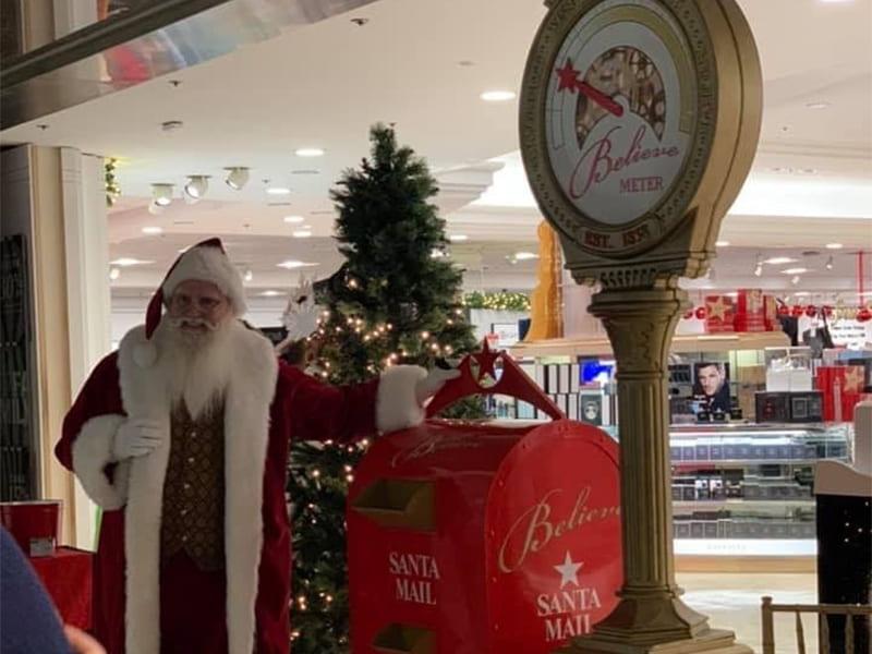 Santa next to mailbox at Macy's