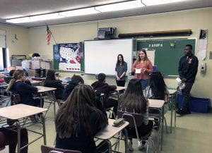 Three ninth-graders speak to a class of eighth-graders at SOMS