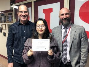 National Merit Finalist Hannah Ahn with Principal Rudy Arietta and Counselor Randy Altman