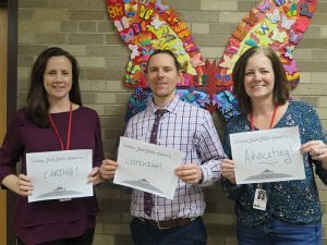 School Counselors holding up signs for National School Counseling Week