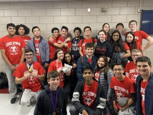 Group photo of TZHS Science Olympiad team with medals