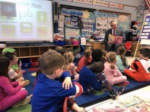 Superintendent Robert Pritchard reads to kindergartners