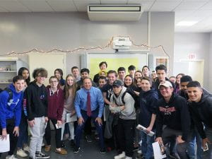 Sports Anchor Bruce Beck standing with TZHS students in classroom