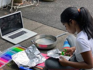Student conducting outdoor experiment