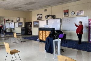 Choral Teacher Russell Wagoner teaching in front of smartboard