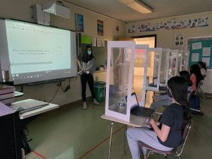 School social worker at smartboard in front of class