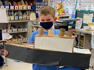 Boy with recycled Titanic model