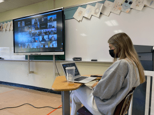 Student participating in virtual NYU WinC conference
