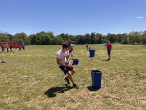 Middle school student competes in sponge soaker challenge at Field Day