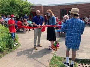 Principal Rudy Arietta helps cut ribbon on rededicated COVE Garden