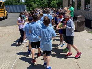 Sixth-graders welcoming fifth-grade visitors