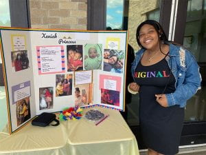 Seventh-grader with Poetry Cafe display board