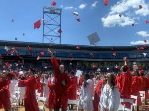TZHS students toss caps in the air at graduation