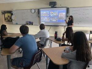 TZHS Spanish V student presenting on El Salvador