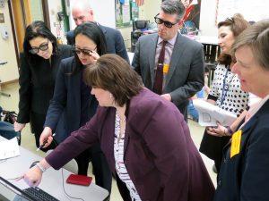 SOMS Principal Karen Tesik demos technology with local ASIs