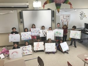K-2 students show off original game boards they created at Summer STEAM Camp in July 2017.
