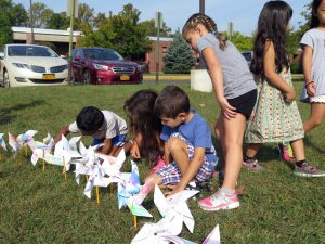 WOS students admire pinwheels at school Pinwheels for Peace art installation
