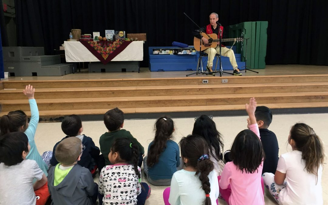 Author Engages WOS Writers in Singing and Storytelling