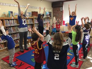 WOS Earth Kids club kicks off meeting with yoga