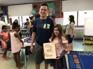 TZHS student shares his autobiographical story with second-grade student