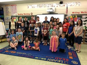 TZHS ELL students with second-graders in Ms. Zatarga's classroom