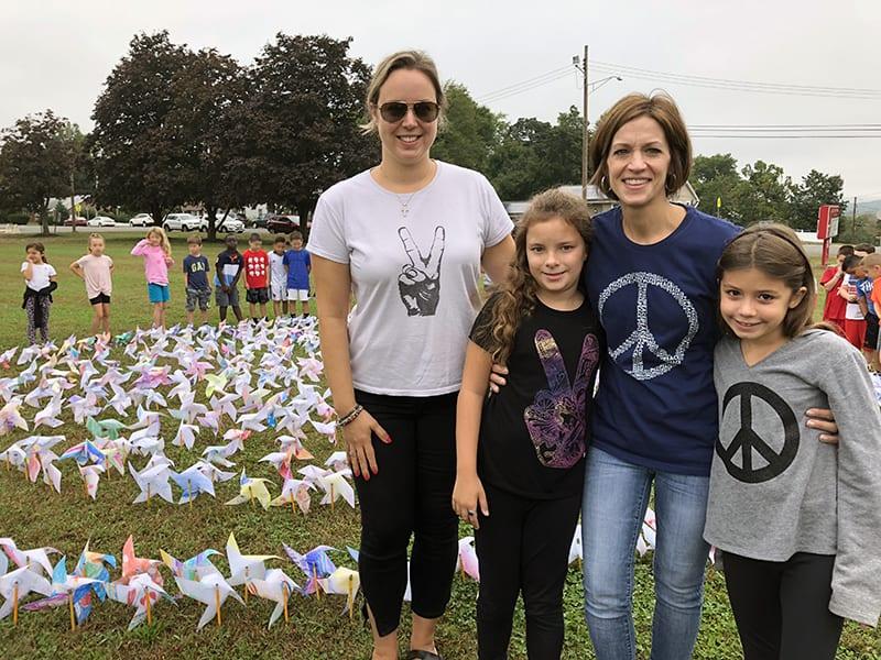 WOS Celebrates Pinwheels for Peace Art Installation