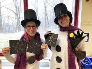 Two teachers dressed as snowmen