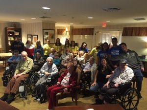 TZHS Italian Honor Society members pose for group photo with residents of Sunrise Senior Living in Old Tappan