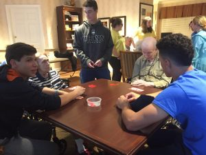Italian Honor Society members playing Tombola with Sunrise Senior Living residents