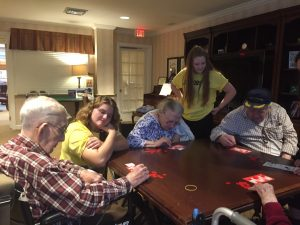 Italian Honor Society members playing Tombola with residents of Sunrise Senior Living