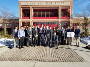 Tappan Zee High School DECA club members in businesswear, standing in front of TZHS